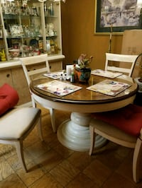 round brown wooden table with four chairs dining set 16 km