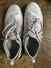 pair of gray Nike running shoes Calgary, T3M 0X4