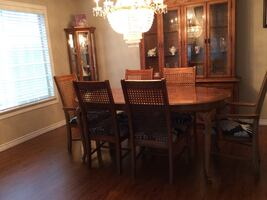 Brown wooden dining table set and hutch