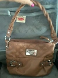 Brown hand bag... Houston, 77009