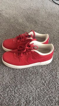 pair of red Nike low top sneakers District Heights, 20747