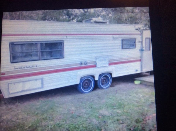 white and red camper trailer