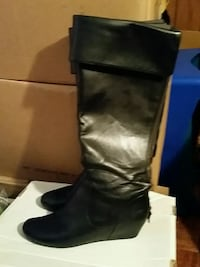 pair of black leather round-toe wedge knee-high boots