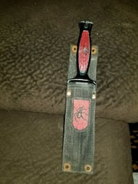 black and red handle knife united uc204 stainless  Eugene