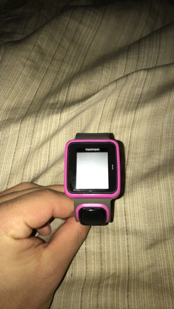 pink and black tomtom smartwatch