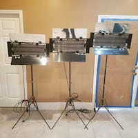 three stainless steel-framed frame stands Pembroke Pines, 33024