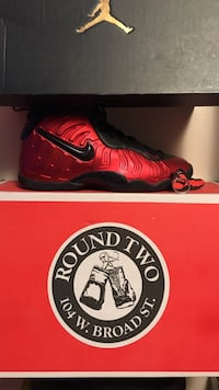Unpaired red and black nike air foamposite shoe with box size 6/5