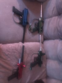 4 paint ball guns and some accessories