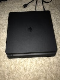 Black sony ps4 slim with dualshock 4 screenshot Lancaster, 93536