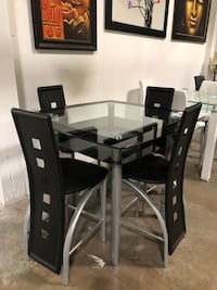 Pub table with 4 chairs. Brand new.  Farmers Branch, 75234