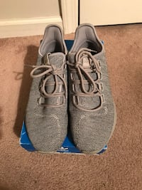 Pair of gray adidas running shoes