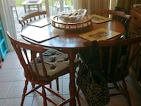 round brown wooden table with four chairs dining s Simcoe County