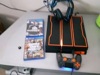 black Sony PS4 with controller and 2 game cases