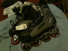 pair of black, grey and red BAUER INLINE SKATES