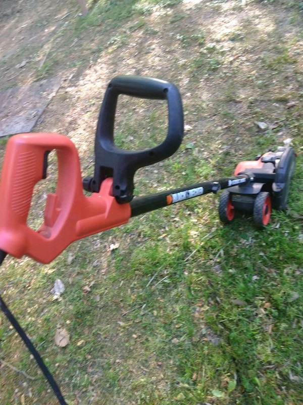 black and red string trimmer a8215de2-307c-466b-8038-79ebe3b82c62
