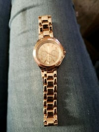 round gold chronograph watch with link bracelet 3154 km