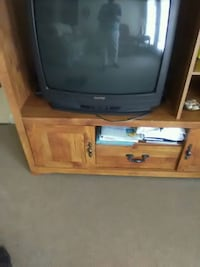 gray CRT television with brown wooden TV stand Burlington, 27215
