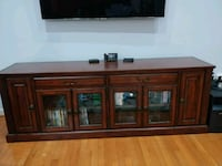 brown wooden TV stand with flat screen television South Riding, 20152