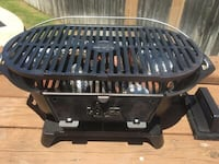 NewLodge L410 Cast Iron Sportsman's Grill With Sliding Coal Door.