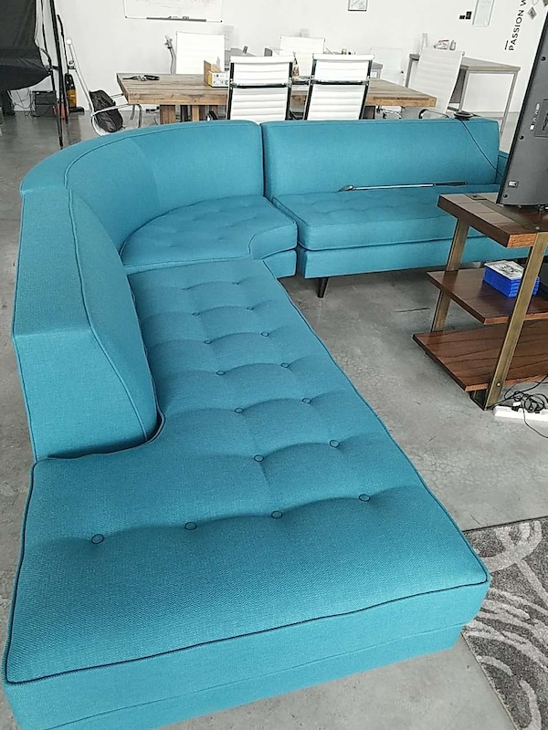 blue tufted padded sectional sofa
