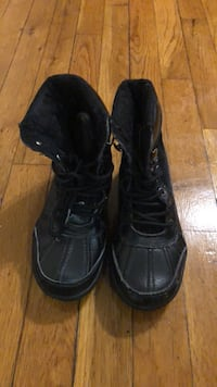 pair of black leather boots New York, 10029