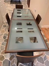 Expandable Glass Dining Table with 4 Leather Padded Chairs Lititz, 17543