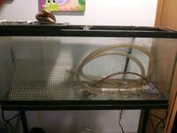 55 gallon fish tank on double stand. No lid. rocks included. no leaks. Des Moines, 50320