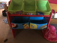 green and blue plastic toy organizer 55 km