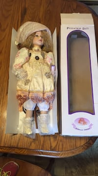 Porcelain doll, Goldenvale Collection. Her leg on the left side was broken but I super glued it. Other wise in great condition, the plastic bubble wrap is still on it. 22 inches  Catawissa, 17820