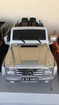 toddler's gray Mercedes-Benz G55 AMG ride-on toy car