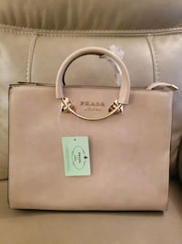 brown leather Michael Kors tote bag Dollard-des-Ormeaux, H9B 2C8