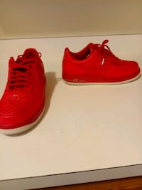 pair of red Nike low-top sneakers