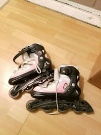 pair of gray-and-black inline skates Longueuil, J4G 1T2