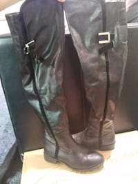 pair of black leather knee-high boots Rochester