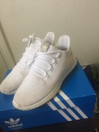 pair of white Adidas low-top sneakers with box