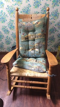 brown wooden frame with tufted teal animal and tree print pad rocking chair Westborough, 01581