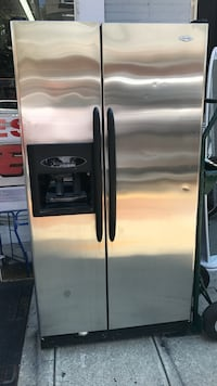 stainless steel side-by-side refrigerator with dispenser 199 mi
