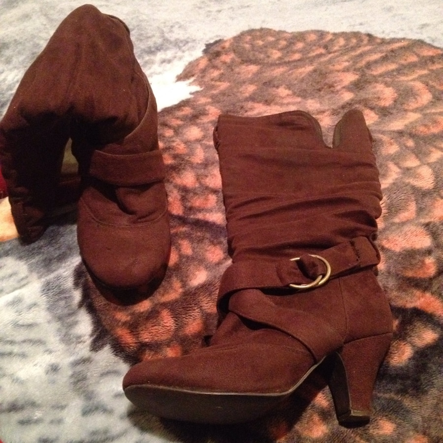 pair of brown heeled boots