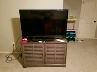 47 black flat screen TV with gray wooden TV stand
