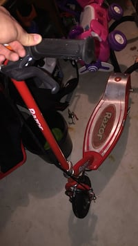 Red and gray Razor electric scooter 59 mi