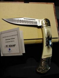 silver and white Freedom pocket knife