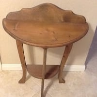 1/2 round brown wooden table