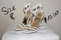 pair of white leather open-toe ankle strap heels 852 mi