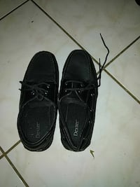 pair of black boat shoes