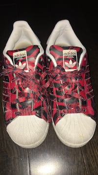 pair of red-white Adidas low-tops sneakers