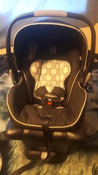 baby's black and yellow car seat carrier