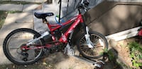 Red and black full-suspension bike ريجينا, S4N 2E4
