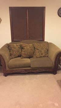 Brown two piece sofa set with table and two end tables. A lot of life still left in this set   Southfield