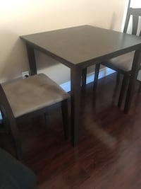 Small kitchen table with 2 chairs.