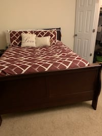 brown wooden bed frame and red mattress 165 mi